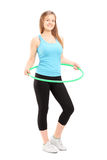 Full length potrait of a young female athlete exercising with a Royalty Free Stock Photos
