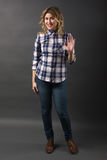 Full length Pretty casual young fashion model in blue jeans posing Royalty Free Stock Images