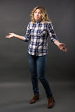 Full length Pretty casual young fashion model in blue jeans posing Royalty Free Stock Photography