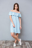 Full length of pretty young female in blue dress Royalty Free Stock Images
