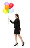 Full-length profile of business woman with balloons. Full-length profile of business woman keeping colorful balloons, isolated on white. Concept of holiday and royalty free stock image
