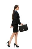 Full-length profile of businesswoman with case Stock Image