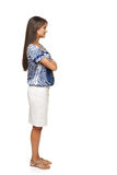 Full length profile of businesswoman. Full length side view business woman standing with folded hands and looking forward, isolated on white background royalty free stock photos