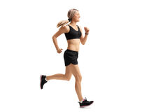 Full length profile shot of a woman running. Isolated on white background royalty free stock photo