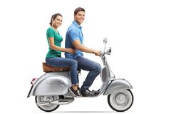 Full length profile shot of young male and female riding on a vintage motorbike. Isolated on white background stock photos