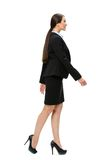 Full length profile of walking business woman. Full-length profile of walking business woman, isolated. Concept of leadership and success stock photos