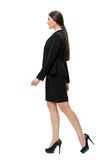 Full-length profile of walking business woman. Isolated on white. Concept of leadership and success royalty free stock photo