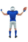 Full length rear view of American football player holding ball Royalty Free Stock Images