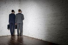 Full length rear view of business colleagues standing in corner at office royalty free stock photography