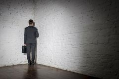 Full length rear view of businessman standing in corner at office stock photos