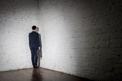 Full length rear view of businesswoman standing in corner at office royalty free stock photo