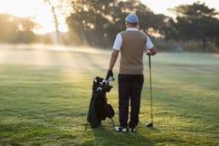 Full length Rear view of golfer Stock Images