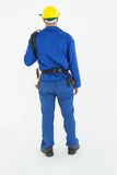 Full length rear view of repairman Stock Images