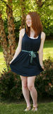 Full length redhead girl in dress Royalty Free Stock Photo