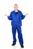 Full length repairman holding copyspace in hands Stock Image