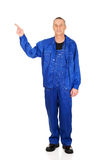 Full length repairman pointing up Royalty Free Stock Photography