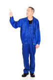 Full length repairman pointing up Royalty Free Stock Photos