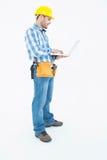 Full length of repairman using laptop Royalty Free Stock Photo
