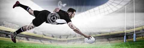 Composite image of full length of rugby player scoring goal. Full length of rugby player scoring goal against rugby pitch Stock Photography