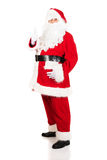 Full length Santa Claus gesturing ok sign Stock Photography