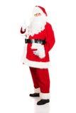 Full length Santa Claus gesturing ok sign Stock Photography