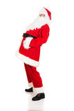 Full length Santa Claus grabbing his belly Stock Images