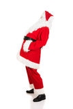 Full length Santa Claus grabbing his belly Stock Photos