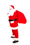 Full length Santa Claus with sack full of presents Royalty Free Stock Images