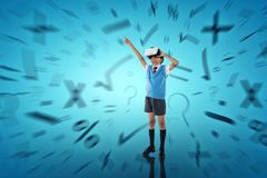 Composite image of full length of school boy wearing vr headset. Full length of school boy wearing VR headset against abstract blue background Royalty Free Stock Photos