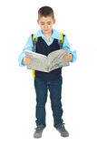 Full length of schoolboy reading Royalty Free Stock Image