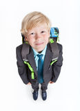 Full-length schoolboy with school backpack on back, isolated white background Royalty Free Stock Photos