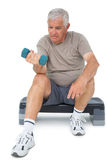 Full length of a senior man exercising with dumbbell Royalty Free Stock Photo