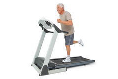 Full length of a senior man running on a treadmill Stock Images