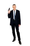 Full length serious mafia agent with handgun Stock Image