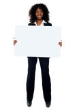 Full length shot of african business lady. Full length shot of african lady promoting big blank banner ad royalty free stock images