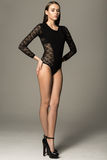 Full length shot of beautiful young woman in black leotard Royalty Free Stock Images