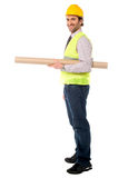Full length shot of a construction engineer. Happy civil engineer holding blueprint Royalty Free Stock Photography