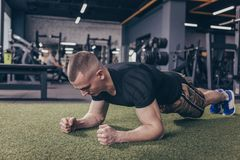 Athletic muscular man exercising at the gym royalty free stock photos