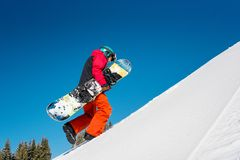Snowboarder exploring snowy mountains Stock Photography