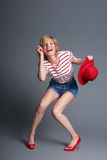 Full length shot of laughing young blond fashion model  in strip Royalty Free Stock Images