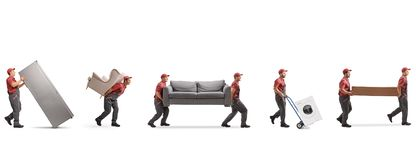 Movers carrying furniture and appliences royalty free stock image