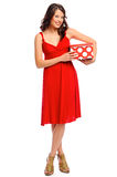 Full length shot of a pretty girl with a present Stock Photography