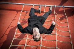 Full length shot of serious 20s man on climbling Stock Image