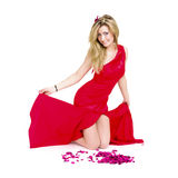 woman in red dress with rose petals Royalty Free Stock Photography