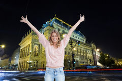 Full length shot of a smiling woman with her arms raised up. Composite image of a full length shot of a smiling woman who has her arms raised up Stock Photography