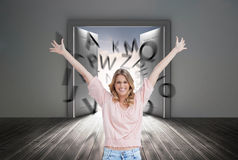 Full length shot of a smiling woman with her arms raised up Royalty Free Stock Image
