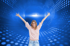Full length shot of a smiling woman with her arms raised up Royalty Free Stock Photography