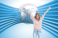 Full length shot of a smiling woman with her arms raised up Stock Photo