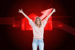 Full length shot of a smiling woman with her arms raised up Stock Photos