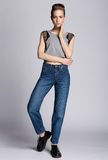 Full length shot of a woman in a gray shirt and blue jeans Royalty Free Stock Images